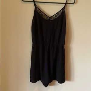 Black romper with lace accent